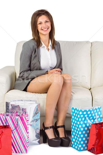 Stock fotó: Mosolyog · fiatal · nő · ül · kanapé · bevásárlótáskák · otthon