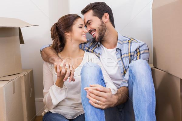Cute couple sitting on floor Stock photo © wavebreak_media