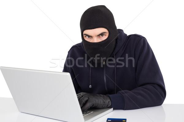 L'hacking laptop bianco computer shopping Foto d'archivio © wavebreak_media