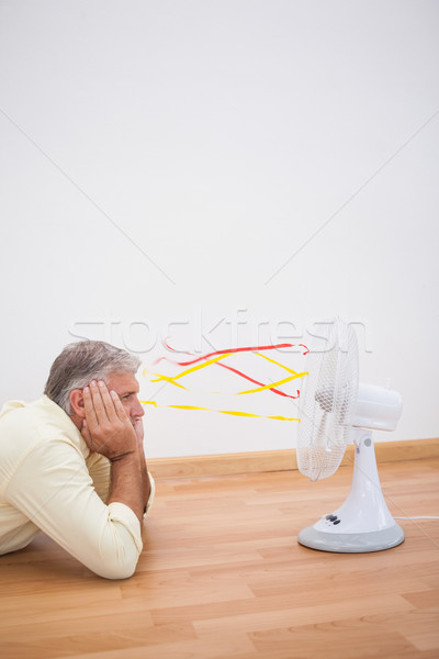 Mann Stock schauen Fan home Wohnzimmer Stock foto © wavebreak_media