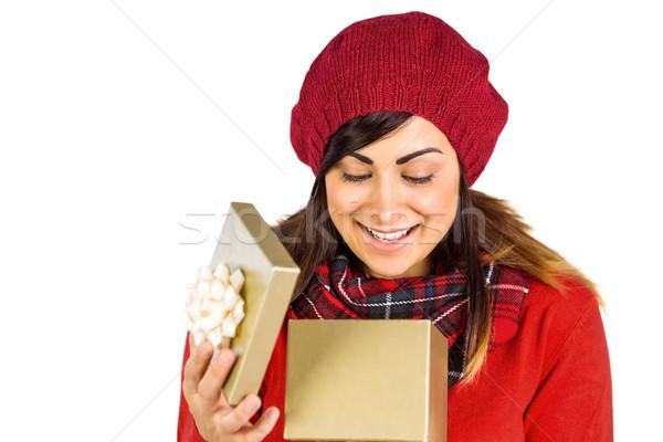 Happy brunette opening christmas gift  Stock photo © wavebreak_media