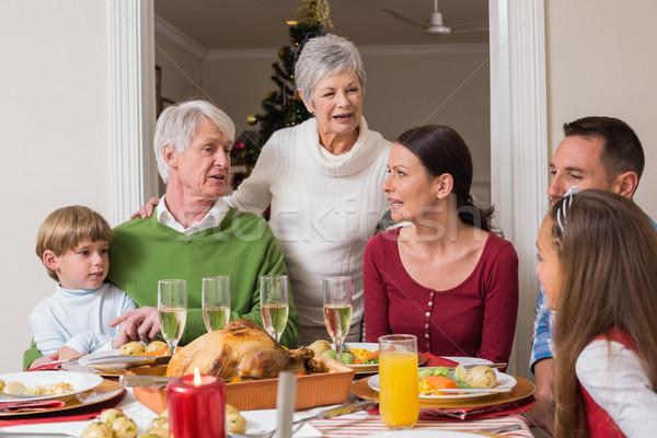 Szczęśliwą rodzinę mówić wraz christmas obiedzie domu Zdjęcia stock © wavebreak_media