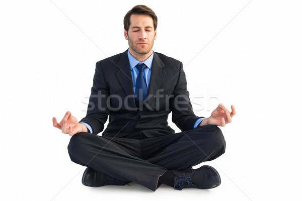 Calm businessman sitting in lotus pose Stock photo © wavebreak_media