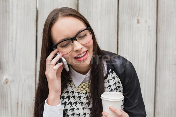Pretty hipster talking on phone having coffee Stock photo © wavebreak_media