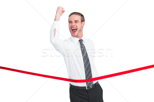 Businessman crossing the finish line while clenching fist Stock photo © wavebreak_media