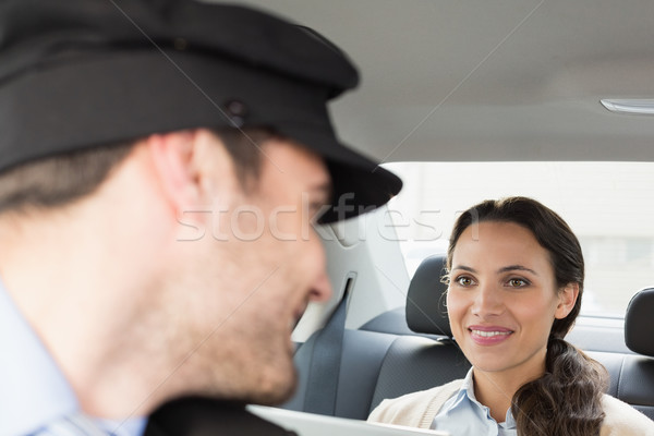 Young businesswoman being chauffeured while working Stock photo © wavebreak_media