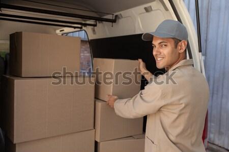 Delivery driver packing his van Stock photo © wavebreak_media