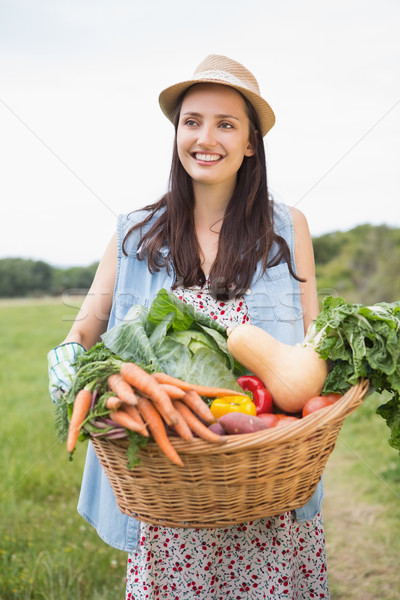 Pretty woman with basket of veg Stock photo © wavebreak_media