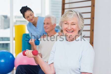 инструктор старший женщину гантели портрет Сток-фото © wavebreak_media