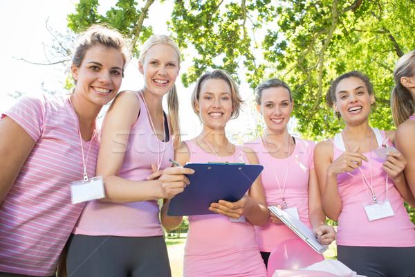 Uśmiechnięty kobiet przypadku rak piersi świadomość Zdjęcia stock © wavebreak_media