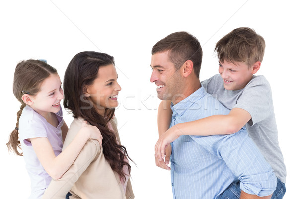 Feliz pais piggyback crianças vista lateral branco Foto stock © wavebreak_media