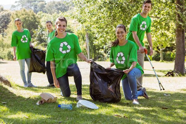 Environmental activists picking up trash Stock photo © wavebreak_media