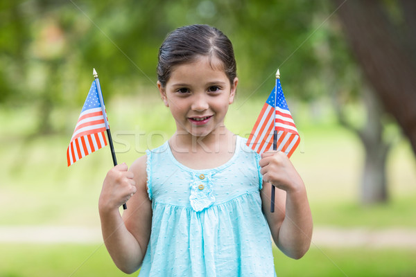 Little girl waving american flag Stock photo © wavebreak_media