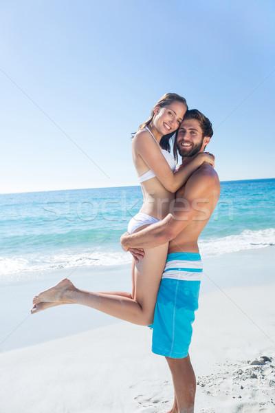 Hombre guapo compañera playa mujer feliz Foto stock © wavebreak_media