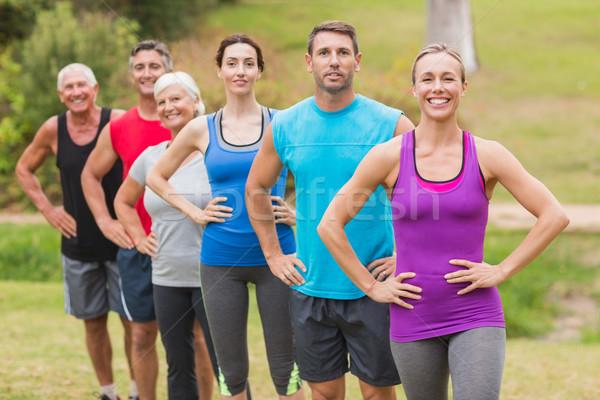 Happy athletic group smiling at camera Stock photo © wavebreak_media