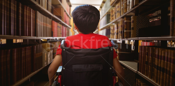 Composite image of rear view of boy sitting in wheelchair Stock photo © wavebreak_media
