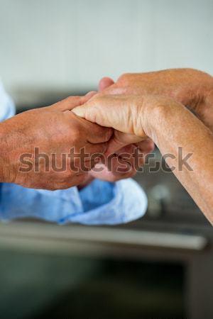 Közelkép üzletemberek kézfogás iroda nő kéz Stock fotó © wavebreak_media