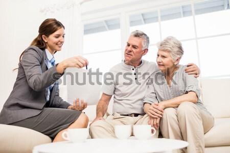 Para kanapie domu salon człowiek szczęśliwy Zdjęcia stock © wavebreak_media