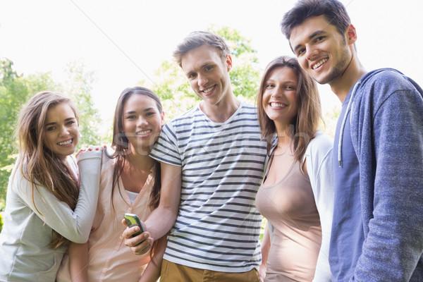 счастливым студентов глядя смартфон за пределами кампус Сток-фото © wavebreak_media