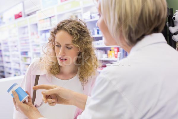 Pharmacist and her customer talking about medication Stock photo © wavebreak_media