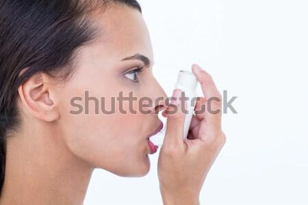 Beautiful using her inhaler  Stock photo © wavebreak_media