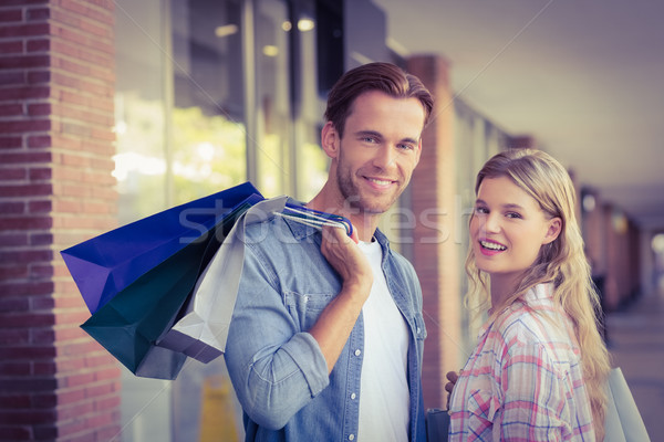 Portrait of a happy couple with shopping bags Stock photo © wavebreak_media