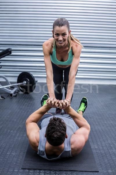 Muscular couple doing core exercises Stock photo © wavebreak_media