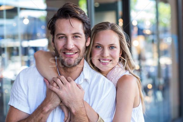 улыбающаяся женщина руки вокруг дружок портрет Сток-фото © wavebreak_media