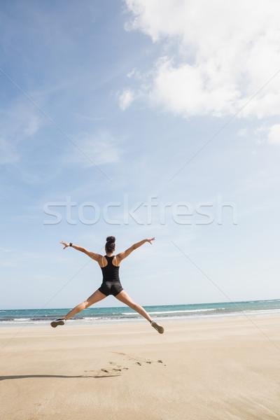 Montare donna sabbia spiaggia mare fitness Foto d'archivio © wavebreak_media