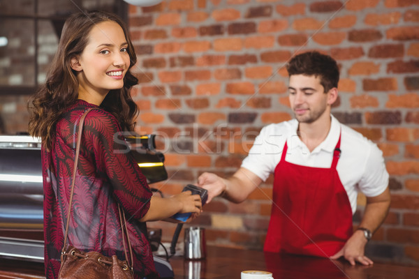 Jolie femme tapant broches portrait femme café Photo stock © wavebreak_media