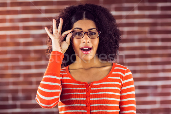 Atrakcyjna kobieta stwarzające okulary portret czerwony Zdjęcia stock © wavebreak_media