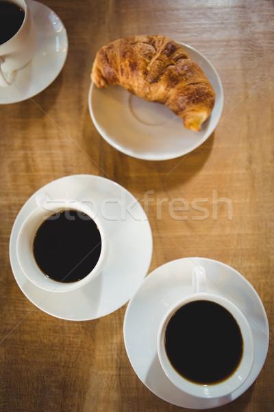 Cups coffee with croissant  Stock photo © wavebreak_media