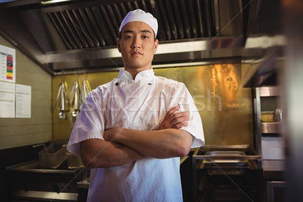 Chef standing with arms crossed in the commercial kitchen Stock photo © wavebreak_media