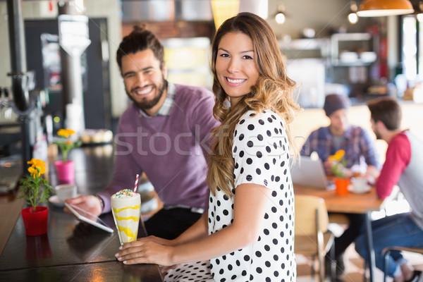 Portrait of smiling woman sitting in restaurant Stock photo © wavebreak_media