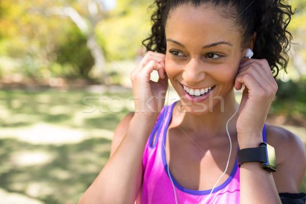 Gülen jogging yapan kadın kulaklık park Stok fotoğraf © wavebreak_media