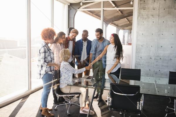 Business entrepreneur interacting with creative team Stock photo © wavebreak_media