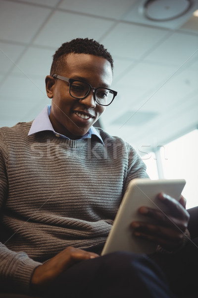 Attentive executive using digital tablet Stock photo © wavebreak_media