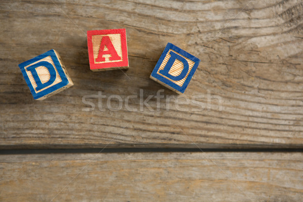 Overhead view of cube shapes with dad text on table Stock photo © wavebreak_media