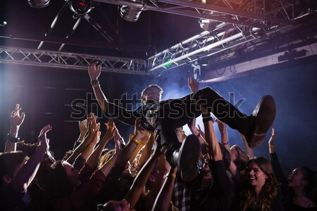 Enthusiastic female singer performing in nightclub Stock photo © wavebreak_media
