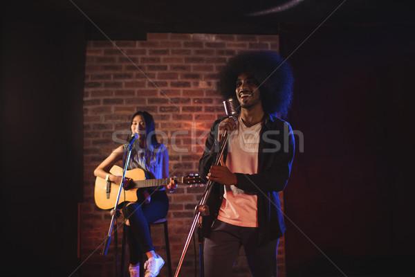 Male and female singers performing in nightclub Stock photo © wavebreak_media