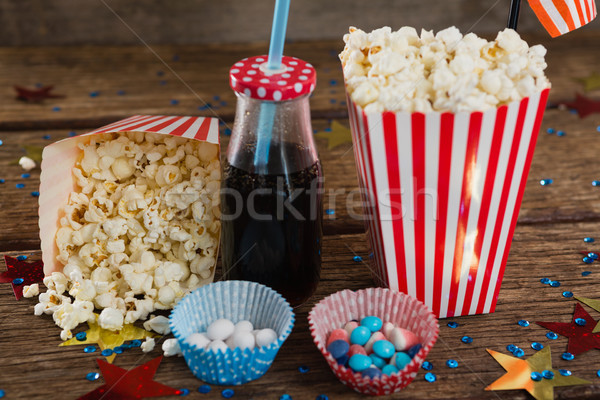 Stock photo: Popcorn, sweet food and cold drink decorated with 4th july theme