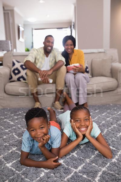 счастливая семья свободное время домой портрет счастливым стены Сток-фото © wavebreak_media