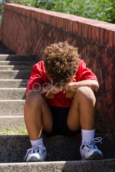 Ontdaan jongen vergadering trappenhuis boot kamp Stockfoto © wavebreak_media