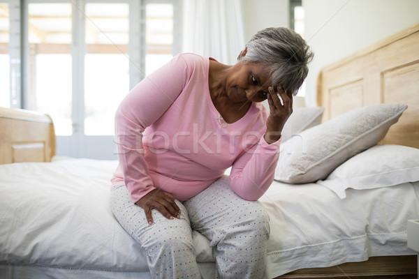 напряженный старший женщину сидят кровать спальня Сток-фото © wavebreak_media