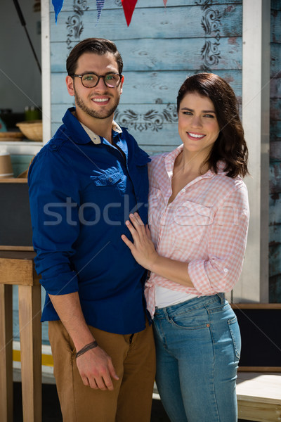Smiling couple standing by food truck Stock photo © wavebreak_media