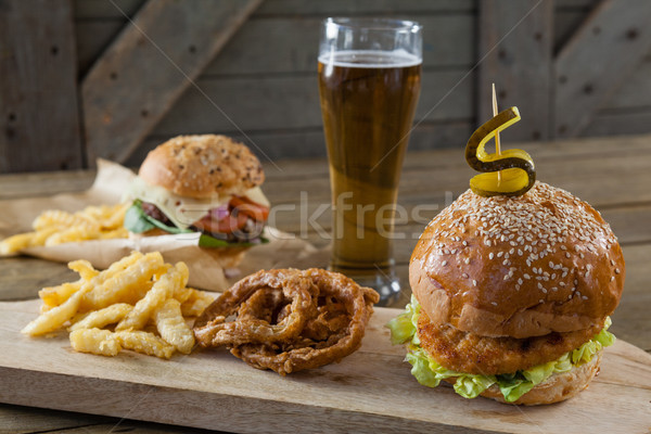 Hamburger, french fries and onion ring with glass of beer Stock photo © wavebreak_media
