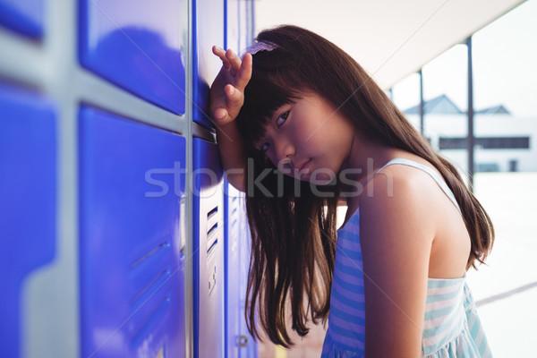Portrait of sad girl leaning on lockers Stock photo © wavebreak_media