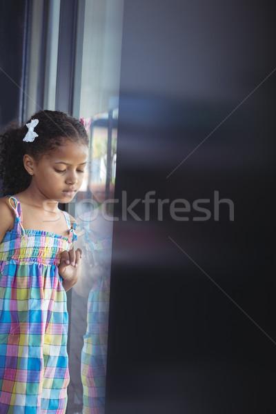 Kız aşağı bakıyor ayakta pencere okul Stok fotoğraf © wavebreak_media