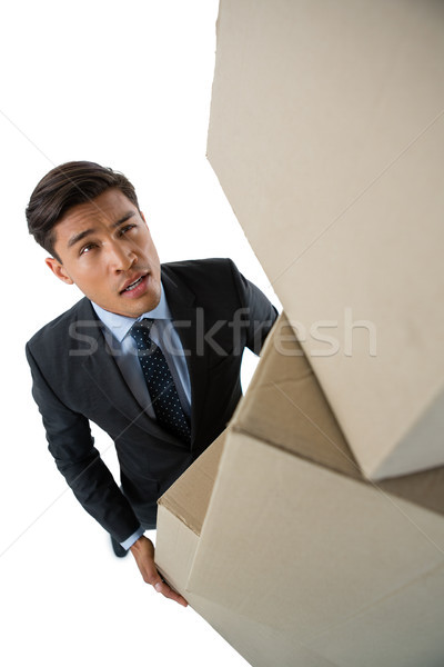 High angle view of businessman carrying cardboard boxes Stock photo © wavebreak_media