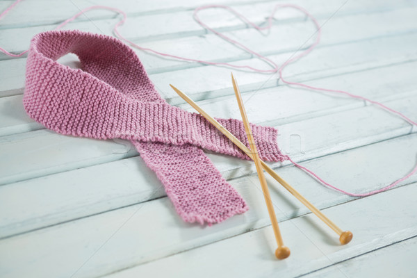 Close-up of woolen Breast Cancer Awareness ribbon with needles and heart shape Stock photo © wavebreak_media